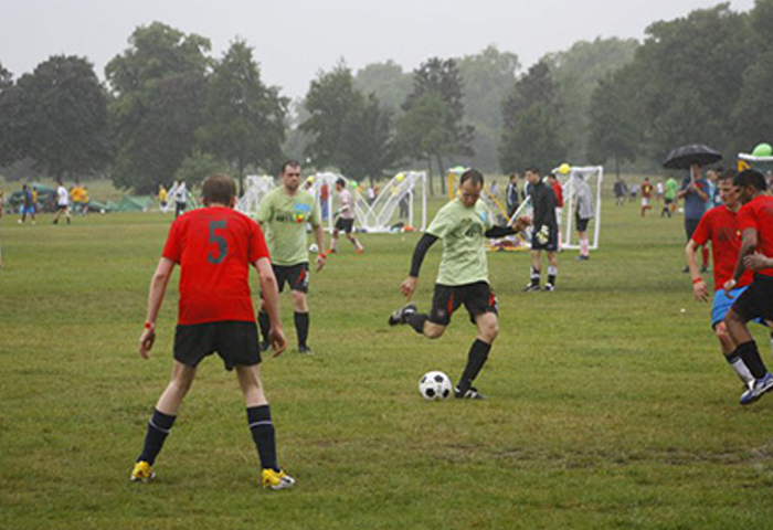 Photo of somone playing football about to kick the ball