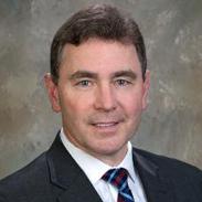 Dennis M. Davin